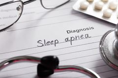 Diagnosis Sleep Apnea Word On Paper With Drugs And Stethoscope. Diagnosis Sleep Apnea On White Paper With Drugs And Stethoscope In Background royalty free stock photos