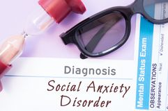 Diagnosis of Social Anxiety Disorder. Hourglass, doctor glasses, mental status exam are near inscription Social Anxiety Disorder. Causes, symptoms, diagnosis Royalty Free Stock Photography