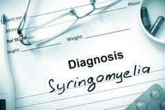 Diagnosis Syringomyelia. Diagnosis Syringomyelia, pills and stethoscope stock photo