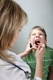 Diagnosis throat of children Royalty Free Stock Photography