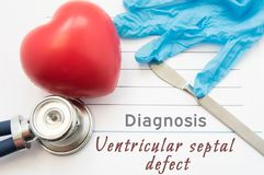 Diagnosis Ventricular septal defect. Figure heart, stethoscope, surgical scalpel and gloves are near title Ventricular septal defe. Ct. Concept for diagnotics of Stock Photos