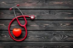 Diagnostic and cure of cardiac disease with stethoscope and heart on wooden background top view mock-up. Family doctor. Cardiologist. Diagnostic and cure of royalty free stock photos