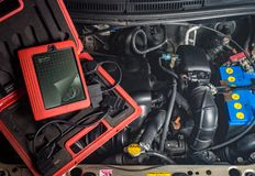 Diagnostic equipment for car repair, motor, wire. Battery stock photography