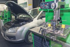 Diagnostic equipment and a car in a car service. Industry royalty free stock photos
