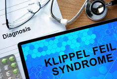 Diagnostic form with diagnosis Klippel Feil syndrome  and pills. Royalty Free Stock Images
