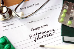 Diagnostic form with diagnosis pulmonary fibrosis. Diagnostic form with diagnosis pulmonary fibrosis and pills royalty free stock photo
