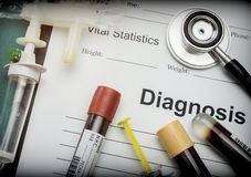 Diagnostic form, Vial of blood samples and Medicine in a hospital, conceptual image stock images
