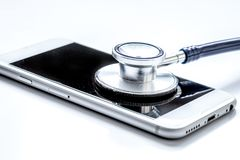 Diagnostic of gadgets on white background with stethoscope royalty free stock photos