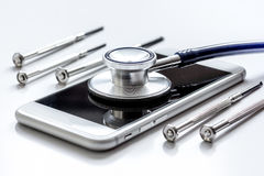 Diagnostic of gadgets on white background with stethoscope.  Royalty Free Stock Photography