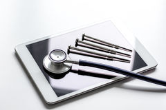 Diagnostic of gadgets on white background with stethoscope.  Royalty Free Stock Photos