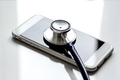 Diagnostic of gadgets on white background with stethoscope.  Royalty Free Stock Photo
