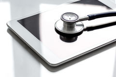 Diagnostic of gadgets on white background with stethoscope.  Stock Photos