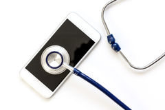 Diagnostic of gadgets on white background with stethoscope.  Royalty Free Stock Images