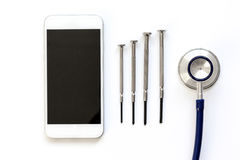 Diagnostic of gadgets on white background with stethoscope top view royalty free stock image