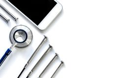 Diagnostic of gadgets on white background with stethoscope top view.  stock images