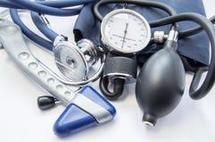 Diagnostic kit of neurologist or internal medicine doctor. Neurological reflex hammer, sphygmomanometer and stethoscope lying on w. Hite background. Diagnosis of Stock Image