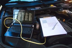 Diagnostic machine ready to be used with car. Diagnostic machine tools ready to be used with car stock photo