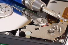 Diagnostic and repair magnetic computer hard disk. Mass memory on white background stock photos