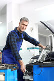 Diagnostic station, mechanic connected diagnostic computer. royalty free stock photos