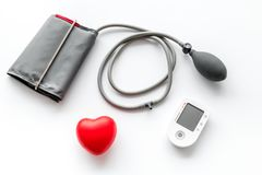 Diagnostics of cardiac disease with pulsimeter on white background top view. Diagnostics of cardiac disease with pulsimeter in office of doctor on white royalty free stock images