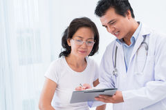 Diagnostics results. Close-up image of a doctor explaining diagnostics results to his patient royalty free stock images
