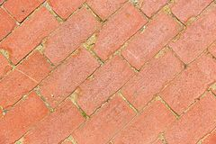 Diagonal aged red brick walkway pattern royalty free stock photography