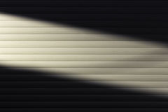 A diagonal beam of light on the wall. The background photo Stock Photos