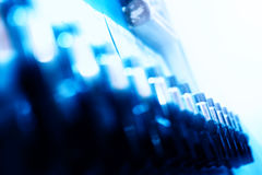 Diagonal blue beer tap bokeh background Royalty Free Stock Photography