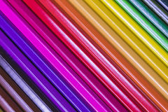 Diagonal color pencils next to each other in a rainbow fashion Stock Photo
