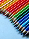 Diagonal and colorful composition. Composition of a sharpened coloured pencils on a neutral background stock image
