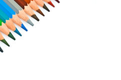Diagonal of colorful wooden pencils isolated on white Royalty Free Stock Images