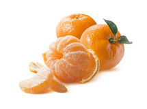Diagonal composition peeled  mandarin and slices  on whi Stock Photos