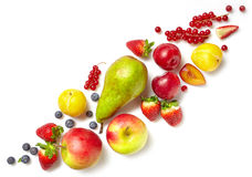 Diagonal composition of various fruits. And berries isolated on white background, top view royalty free stock photography
