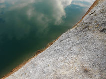 Diagonal. Conceptual water soft rough stone contrast clouds reflection reflex Stock Photos