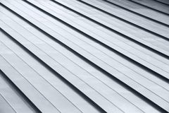 Diagonal corrugated metal gray rooftop surface royalty free stock photo