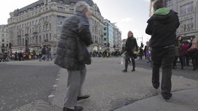 Diagonal Crossing. LONDON, UNITED KINGDOM - JANUARY 27, 2013: Diagonal Crossing at Oxford Circus People Intersection in London, United Kingdom stock video footage