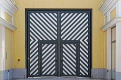 Diagonal doors. Big double door with diagonal stripe lines Stock Photography