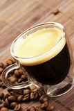 Diagonal espresso with coffee beans Royalty Free Stock Photography