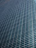 Diagonal facade pattern. Diagonal pattern of an all glass building facade Stock Photography