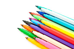 Diagonal fragment of opened colorful markers Royalty Free Stock Images