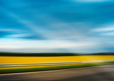 Diagonal highway vivid summer landscape motion blur abstraction Royalty Free Stock Photography