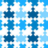 Diagonal jigsaw puzzle seamless pattern. Blue puzzle pieces geometric pattern. Seamless Tile. Colors can be changed upon request Royalty Free Stock Photography