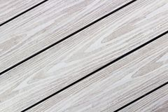 Diagonal, textured, light colored wood planks. Diagonal, light colored wooden planks with wood texture Stock Photos