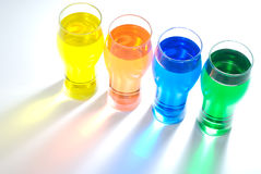 Diagonal line of beer glass and color water Royalty Free Stock Photography