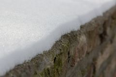 Diagonal line of snow on bricks royalty free stock photo