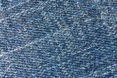 Diagonal lines macro blue jeans Royalty Free Stock Photography