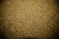 Diagonal material background. Extreme close-up of brown material background stock photos
