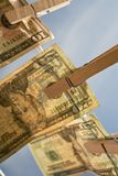 Diagonal Money on Clothesline Royalty Free Stock Image