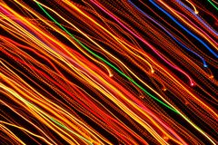 Diagonal Multicolored Glowing Lines on Dark Background Royalty Free Stock Photos