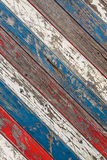 Diagonal old planks painted white, red and blue. Background of diagonal old weathered planks painted in white, red and blue royalty free stock images